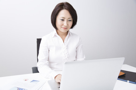 Businesswoman working with PC photo