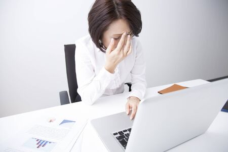 tiring: Businesswoman tiring to desk work Stock Photo