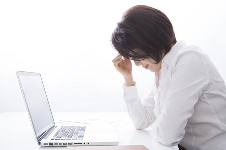 business concern: Businesswoman tiring to desk work Stock Photo