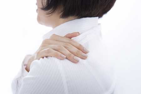 stiffness: Businesswoman suffer from shoulder stiffness