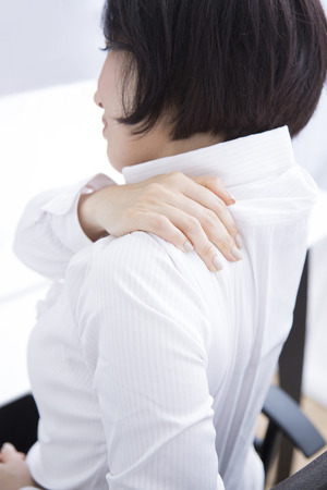 working stiff: Businesswoman suffer from shoulder stiffness