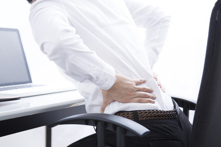 low back: Business woman suffering from low back pain Stock Photo