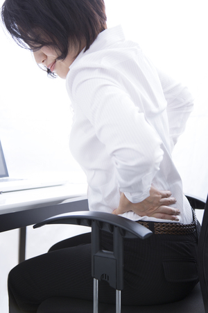 low back pain: Business woman suffering from low back pain Stock Photo