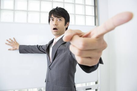 business for the middle: Man pointing a finger