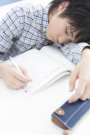 dozing: Elementary school students to the dozing in study Stock Photo