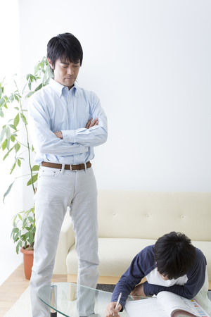 two generations: Father teaching son to study and
