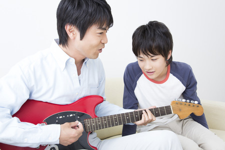 nuclear family: Parent-child play guitar