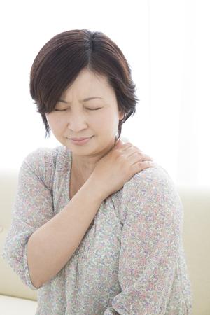 stiff: Middle women suffer from stiff neck Stock Photo