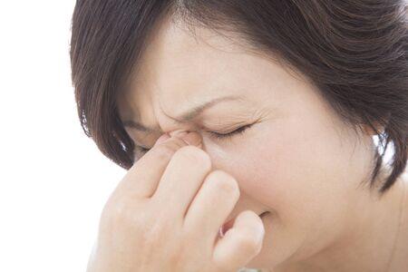 eyestrain: Middle women pinch the glabellar