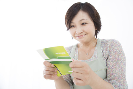 Bank passbook stock photos royalty free bank passbook images housewife pleased to see the passbook colourmoves