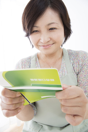 passbook: Housewife pleased to see the passbook