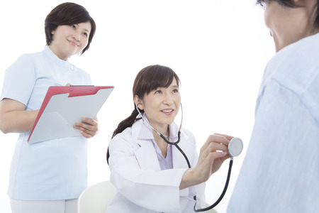 nursing record: Woman doctor that the examination and nurses Stock Photo