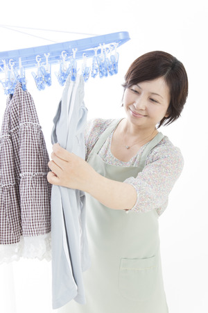 Housewife hanging laundry