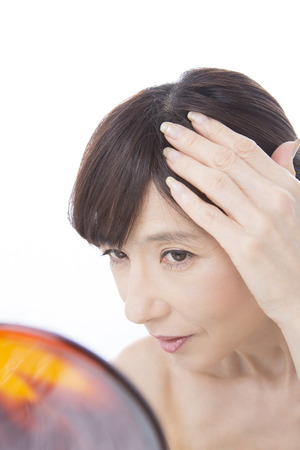 Middle woman to worry about the gray hair