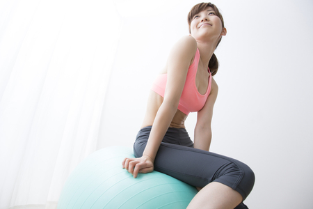 balance ball: Woman sitting on balance ball