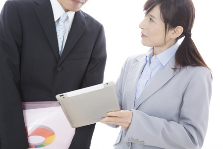 superiors: Superiors and subordinates to talk with the tablet PC Stock Photo