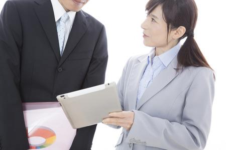 subordinates: Superiors and subordinates to talk with the tablet PC Stock Photo