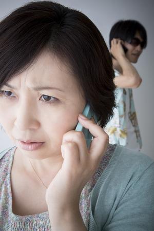 hoodlum: Middle women undergoing suspicious phone Stock Photo