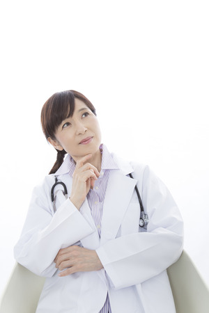 lost in thought: Woman doctor who lost in thought Stock Photo