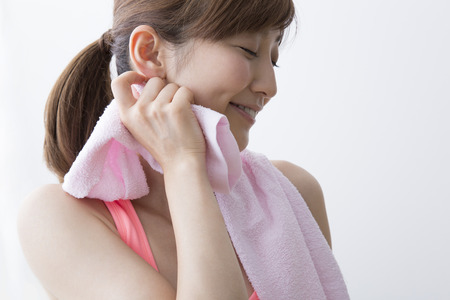 Woman in a towel to wipe the sweat photo