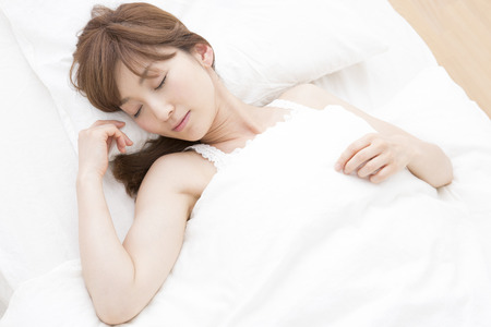 early 30s: Woman to sleep in bed Stock Photo