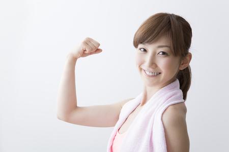 Women make a bicep 版權商用圖片