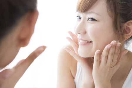 check ups: Woman to check your skin Stock Photo
