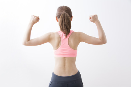 From behind the fitness style woman