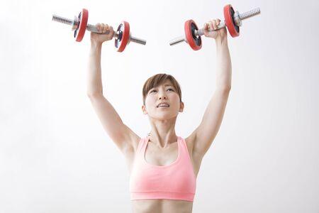 muscle training: Woman to Weight Training Lizenzfreie Bilder