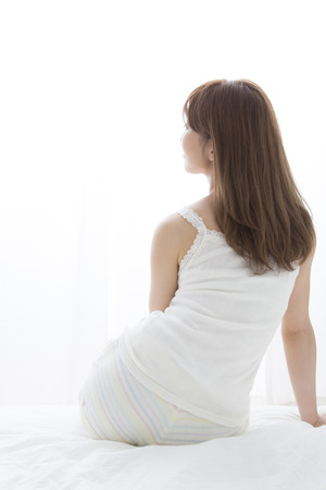 early 30s: back view of women who sit