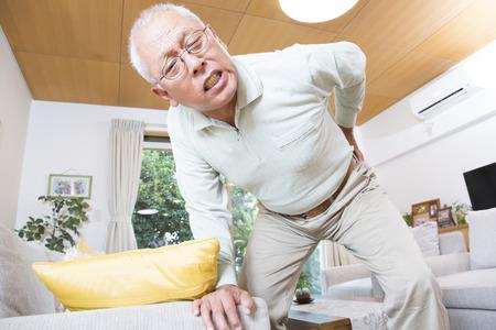the elderly residence: Senior men who suffer from low back pain