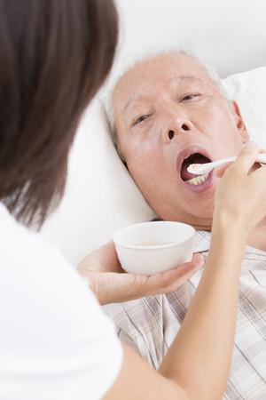 the elderly residence: Receive a dietary supplement senior men