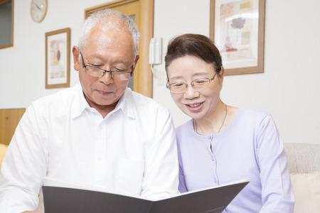 Senior couple to open the brochure