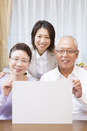 granny and grandad: Senior couple smiling with a message board Stock Photo