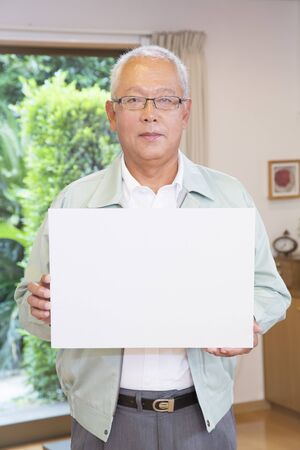 the elderly residence: Engineering clerk with a message board Stock Photo