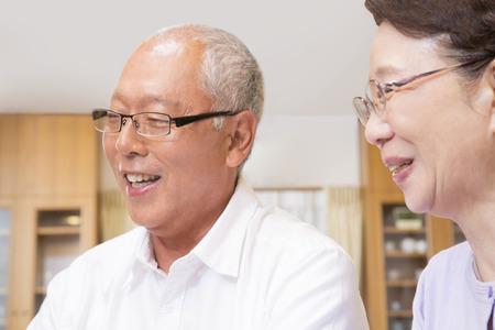 granny and grandad: Smiling senior couple Stock Photo