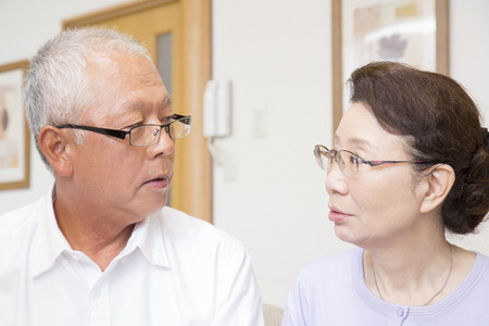 grandad: Senior couple look at each other Stock Photo