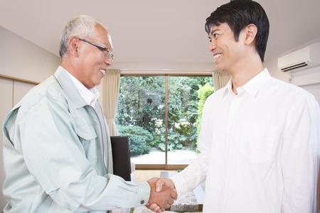 the elderly residence: Handshake to engineering clerk and men Stock Photo