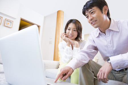 Middle couple to operate the notebook PC Stock Photo