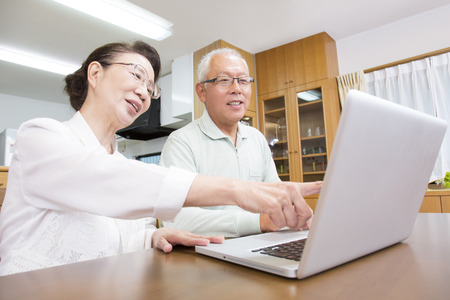 the elderly residence: Senior couple working with notebook PC