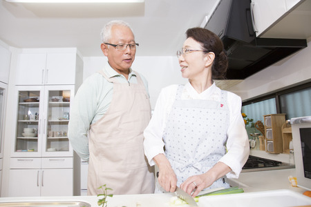 happy asian people: Senior couple that conversation in the kitchen