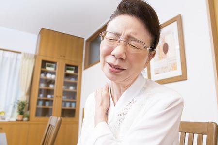 the elderly residence: Senior women suffer from stiff neck Stock Photo