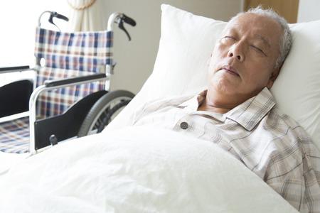 Senior men sleep in the bed
