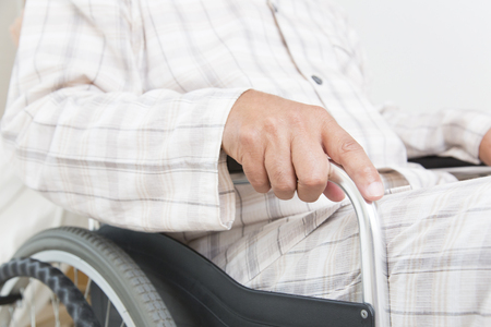 hospitalization: Hand of a senior man sitting in a wheelchair