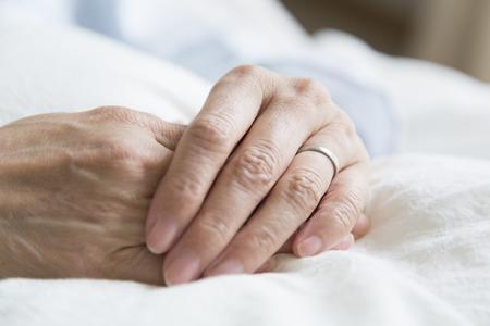 fostering: Hand of senior woman Stock Photo