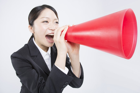 job hunting: Job hunting woman to cheer with megaphone Stock Photo
