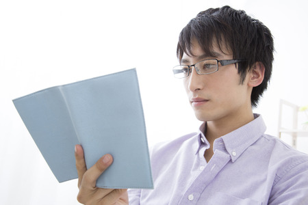 loosen up: Man to be reading in the living room