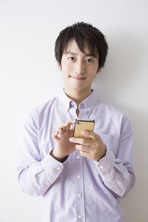 loosen up: Man smiling with a smartphone