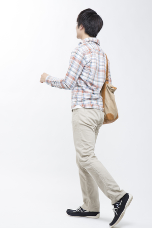 10s: from behind the men who walk Stock Photo