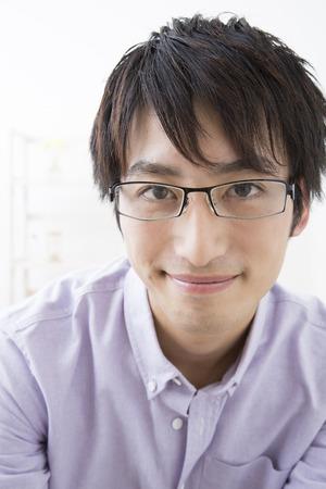 loosen: Man smiling over glasses Stock Photo